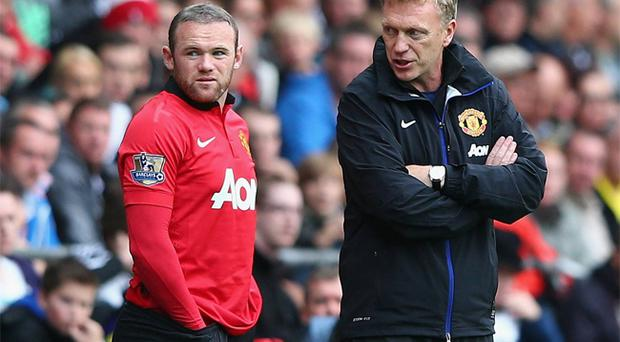 David Moyes gives instructions to Wayne Rooney during Manchester United's Barclays Premier League match between Swansea City on 17 August