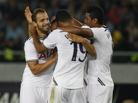 Tottenham's players celebrate with Mousa Dembele, center, their victory against Dinamo Tbilisi during their Europa League playoff first leg soccer match in Tbilisi, Georgia, Thursday, Aug. 22, 2013. (AP Photo/Shakh Aivazov)