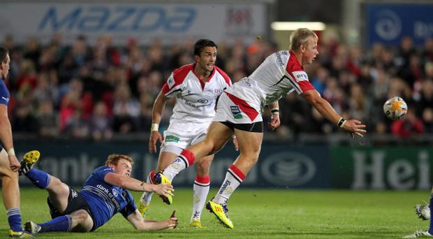 Ulster's Luke Marshall is tackled by Leinster's Tom Dent
