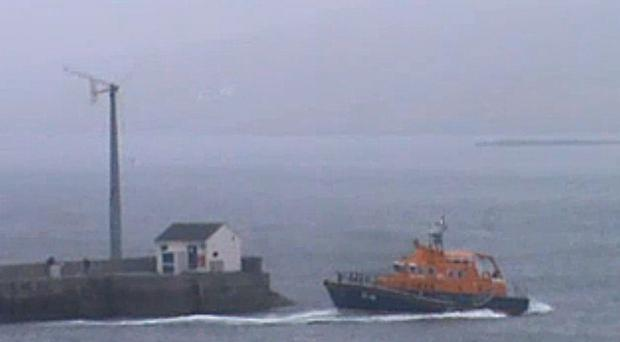 Undated video still issued by the RNLI of the Aith lifeboat responding to the helicopter that ditched in the sea off Shetland at 6.20pm yesterday