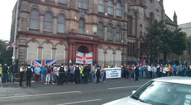 Loyalists gathered outside Clifton Street Orange Hall in protest over a the nearby republican parade