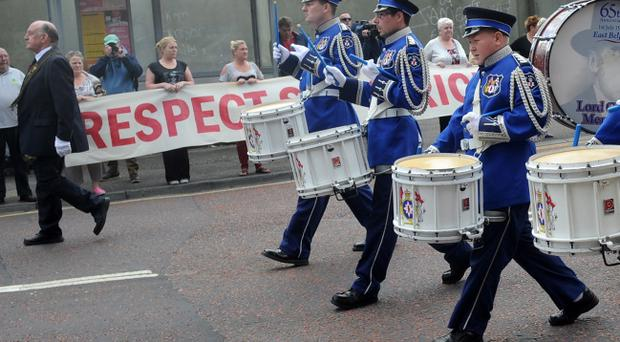 Pacemaker Press 25/8/2013Ê A Royal Black Preceptory parade passes Donegal Street in Belfast on sunday , A heavy police presence was in place as The Royal Black Preceptory parade and a republican parade have both passed off peacefully Pic Colm Lenaghan/PacemakerÊ