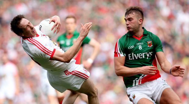 GAA Football All Ireland Senior Championship Semi-Final, Croke Park, Dublin 25/8/2013 Mayo vs Tyrone Mayo's Aidan O'Shea tackles Colm Cavanagh of Tyrone which resulted in a yellow card Mandatory Credit ©INPHO/James Crombie