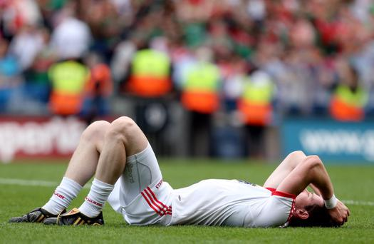 GAA Football All Ireland Senior Championship Semi-Final, Croke Park, Dublin 25/8/2013 Mayo vs Tyrone Tyrone's Conor Clarke dejected at the final whistle Mandatory Credit ©INPHO/James Crombie