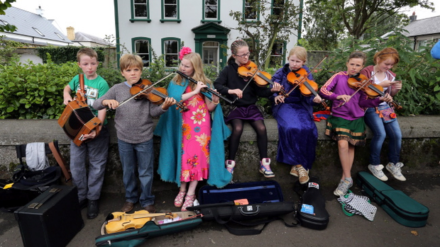 Members of Ballycastle Comhaltas, perform in the junior street busking competition in Ballycastle, Co Antrim, on the first day of the Ould Lammas Fair. PRESS ASSOCIATION Photo. Picture date: Monday August 26, 2013. Paul Faith/PA Wire