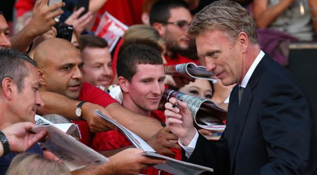 MANCHESTER, ENGLAND - AUGUST 26: Manchester United Manager David Moyes signs autographs prior to the Barclays Premier League match between Manchester United and Chelsea at Old Trafford on August 26, 2013 in Manchester, England. (Photo by Alex Livesey/Getty Images)