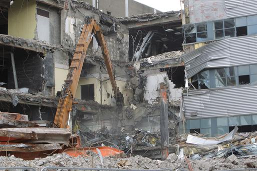 Contractors begin to demolish the former Co-op site on York Street