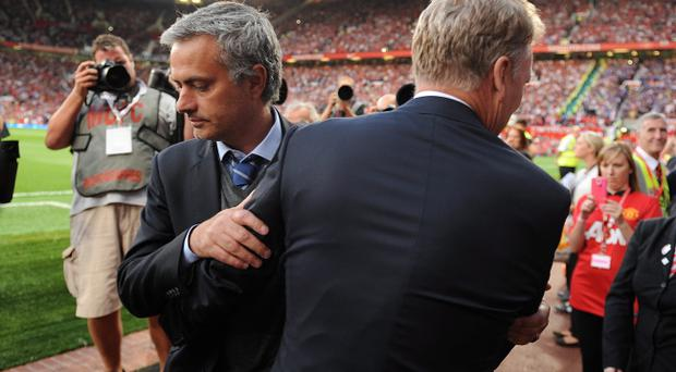 Manchester United manager David Moyes (right) embraces Chelsea manager Jose Mourinho prior to kick-off during the Barclays Premier League match at Old Trafford, Manchester, Monday August 26, 2013
