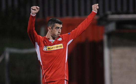 Cliftonville's Joe Gormley salutes the crowd after scoring a penalty