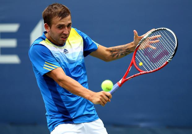 NEW YORK, NY - AUGUST 26: Daniel Evans of Great Britain returns a shot against Kei Nishikori of Japan during their first round men's singles match on Day One of the 2013 US Open at USTA Billie Jean King National Tennis Center on August 26, 2013 in the Flushing neigborhood of the Queens borough of New York City. (Photo by Al Bello/Getty Images)