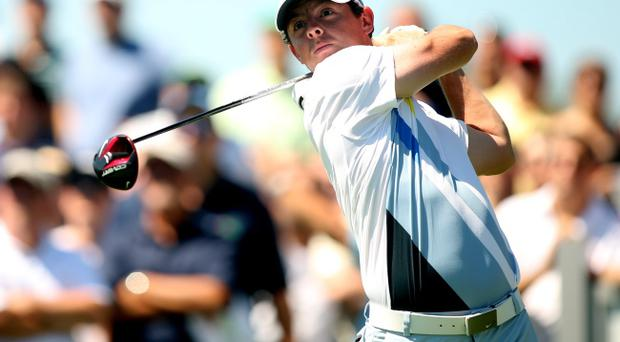 JERSEY CITY, NJ - AUGUST 24: Rory McIlroy of Northern Ireland watches his tee shot on the sixth hole during the third round of The Barclays at Liberty National Golf Club on August 24, 2013 in Jersey City, New Jersey. (Photo by Darren Carroll/Getty Images)