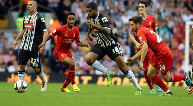 Notts County Joss Labadie and Liverpool's Raheem Sterling during the Capital One Cup, Second Round match at Anfield, Liverpool.