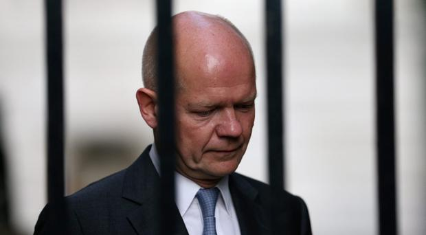 LONDON, ENGLAND - AUGUST 28: British Foreign Secretary William Hague arrives in Downing Street on August 28, 2013 in London, England. Prime Minister David Cameron is due to chair a meeting of the National Security Council today before Parliament's recall tomorrow to debate the UK's response to a suspected chemical weapon attack in Syria. (Photo by Oli Scarff/Getty Images)