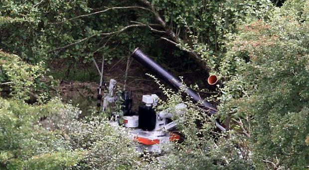 A general view of an army robot at work near the village of Cullyhanna where a mortar bomb was discovered. Pic Paul Faith