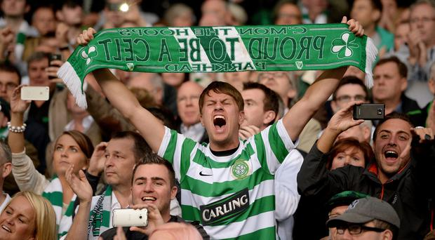 Celtic fans react during the UEFA Champions League Play-off second leg match between Celtic and Shakhter Karagandy at Celtic Park