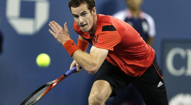 Andy Murray, of Britain, chases down a return against Michael Llodra, of France, during the first round of the 2013 U.S. Open tennis tournament, Wednesday, Aug. 28, 2013, in New York. Murray defeated Llodra. (AP Photo/Charles Krupa)