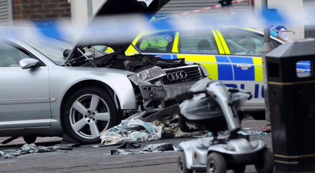 The scene after a silver Audi car mounted the pavement and collided with several pedestrians on the Woodstock road in east Belfast Pic Colm Lenaghan/Pacemaker