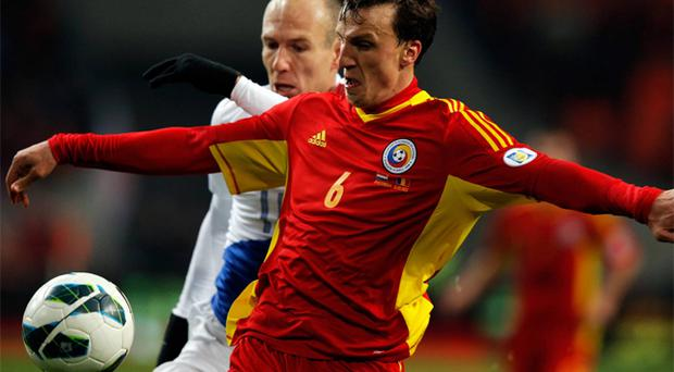 Vlad Chiriches, in action for Steaua Bucharest agains Arjen Robben of Bayern Munich, has been linked with a move to Tottenham