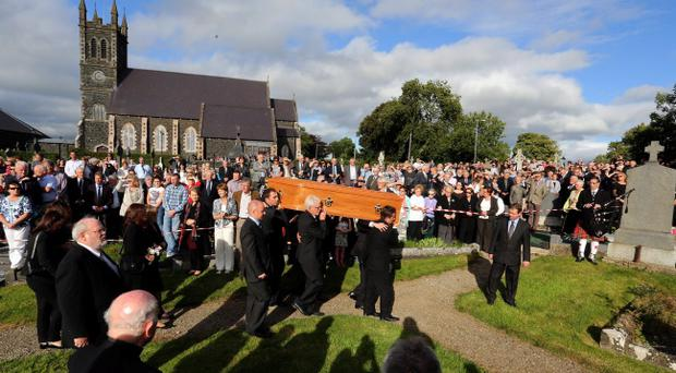 Nobel Laureate Seamus Heaney is laid to rest in his native Bellaghy in County Londonderry.