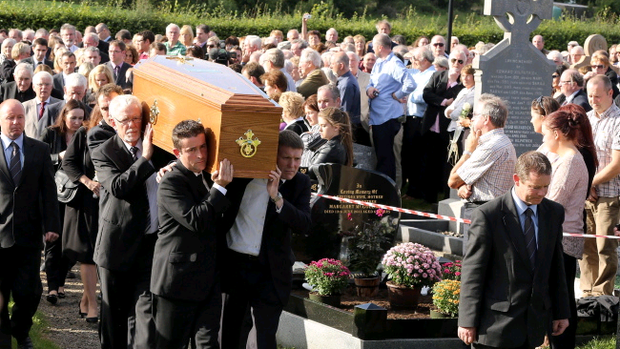 The family of Nobel Laureate poet Seamus Heaney, carry his coffin at St Marys Church Bellaghy, in Co Londonderry where he will be buried. PRESS ASSOCIATION Photo. Picture date: Monday September 2, 2013. See PA story FUNERAL Heaney. Photo credit should read: Paul Faith/PA Wire