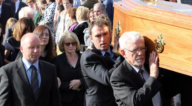 Marie Heaney (centre) the widow of Nobel Laureate poet Seamus Heaney accompanied by daughter Catherine Ann, walk behind his coffin as it is carried at St Marys Church Bellaghy, in Co Londonderry where he will be buried. PRESS ASSOCIATION Photo. Picture date: Monday September 2, 2013. See PA story FUNERAL Heaney. Photo credit should read: Paul Faith/PA Wire