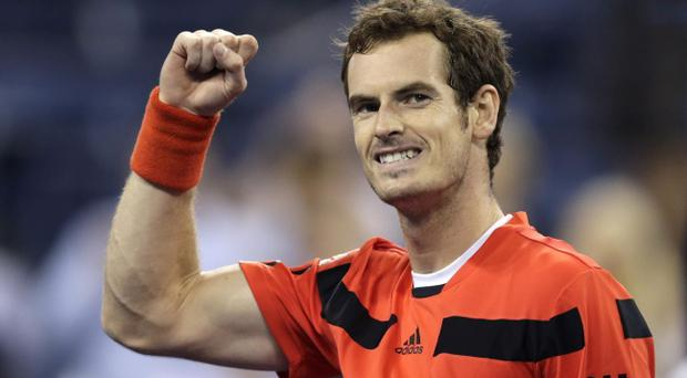 Andy Murray, of Britain, pumps his fist after defeating Denis Istomin, of Uzbekistan, during the fourth round of the U.S. Open tennis tournament, Tuesday, Sept. 3, 2013, in New York. Murray won 6-7 (5), 6-1, 6-4, 6-4. (AP Photo/Charles Krupa)