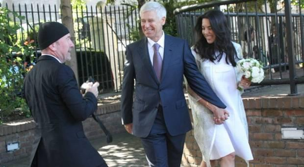The Edge snaps Adam Clayton and Mariana de Carvalho as they leave the office, having just got married. Photo: Mark Doyle