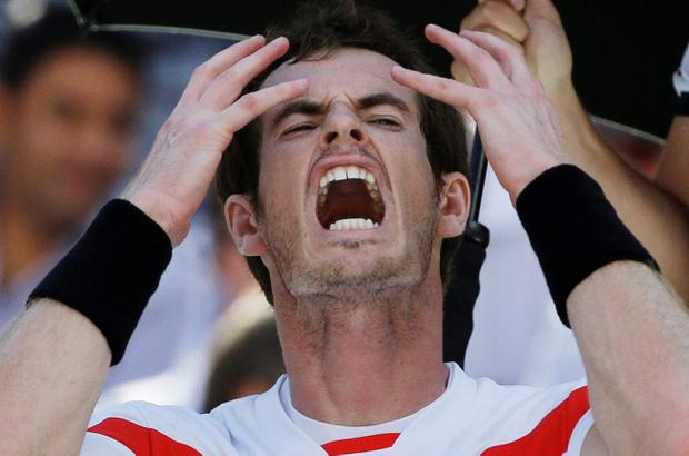 Andy Murray, of Great Britain, reacts during a break between sets after losing the first two sets to Stanislas Wawrinka, of Switzerland, during the quarterfinals of the 2013 U.S. Open tennis tournament, Thursday, Sept. 5, 2013, in New York. (AP Photo/David Goldman)