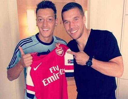 Mesut Ozil poses with new Arsenal team-mate Lukas Podolski while on duty with the Germany. Podolski, currently out with a hamstring injury, was being examined by the national team doctor. Photo: Instagram