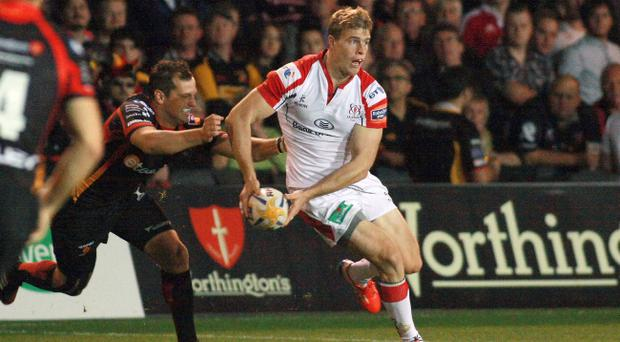 Newport Gwent Dragons v Ulster - RaboDirectPro12 - Ulster's Andrew Trimble offloads as Dragons' Dan Evans tackles