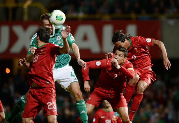 Gareth McAuley rises to beat Ronaldo and score the equaliser score during the 2014 World Cup qualifier between Northern Ireland and Portugal at Windsor Park, Belfast. 6/9/2013 Picture Charles McQuillan/Pacemaker.