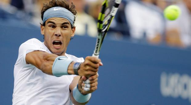 Rafael Nadal of Spain returns a shot to Richard Gasquet, of France, during the semifinals of the 2013 U.S. Open tennis tournament, Saturday, Sept. 7, 2013, in New York. (AP Photo/Darron Cummings)