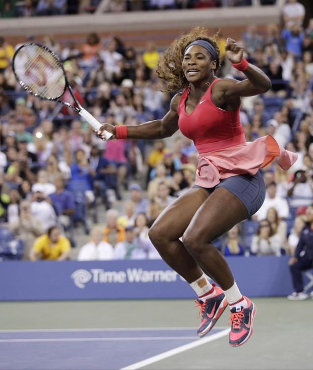 Serena Williams reacts after beating Victoria Azarenka