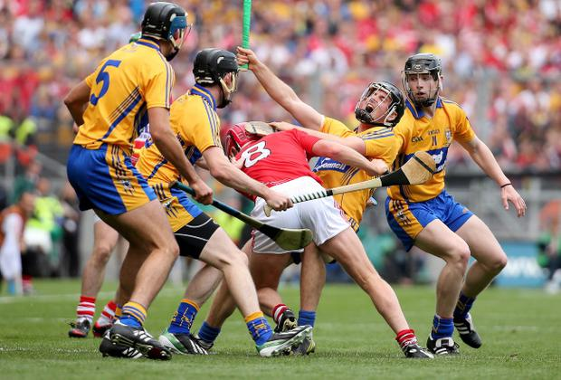 Clash of the ash: Cork's Lorcan McLoughlin fells Clare's Colin Ryan in Sunday's dramatic All-Ireland Hurling final which ended in a draw