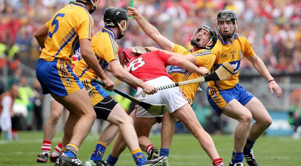 Clash of the ash: Cork's Lorcan McLoughlin fells Clare's Colin Ryan in yesterday's dramatic All-Ireland Hurling final which ended in a draw