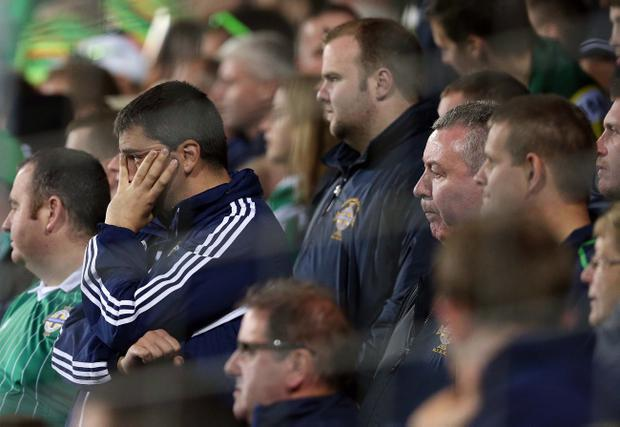 Northern Ireland's fans are dejected after being defeated 3-2 by Luxembourg in Tuesday nights World Cup qualifier at the Stade Josy Barthel stadium, Luxembourg.