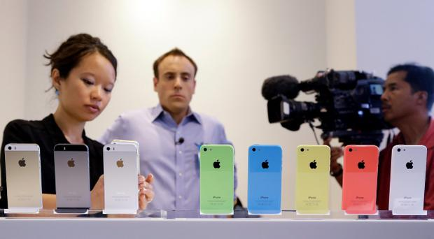 The new iPhone 5c and 5s during a new product announcement at Apple headquarters