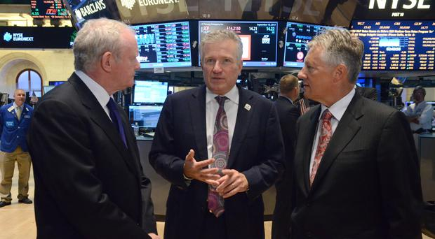 First Minister Peter Robinson and deputy First Minister Martin McGuinness are shown the trading floor of the New York Stock Exchange by Chief Executive of the NYSE Duncan Niederauer.