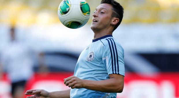 Mesut Ozil controls the ball during a training session for the FIFA World Cup 2014 qualification group C soccer match between Germany and Austria in Munich, southern Germany, Thursday, Sept. 5, 2013. The match is played on Sept. 6, 2013. (AP Photo/Matthias Schrader)