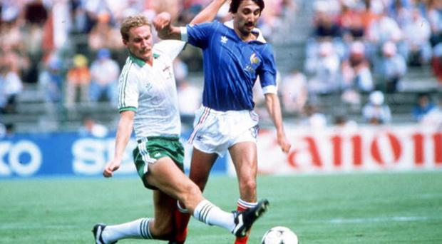 Sunday best: Billy Hamilton tackles France's Bernard Genghini during the second phase World Cup game in Spain, 1982, when Northern Ireland first played a competitive game on a Sunday
