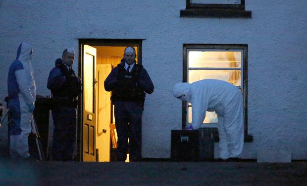 Activity at the scene in Feystown Road, Glenarm, Co Antrim, where two men were found dead