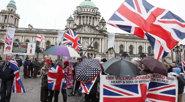 A Union Flag protest at Belfast City Hall in March. Loyalists have been protesting since the start of December last year over Belfast City Council's vote to only flay the Union Flag on certain days.