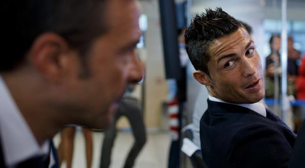 MADRID, SPAIN - SEPTEMBER 15: Crsitiano Ronaldo (R) speaks with his agent Jorge Mendes (R) after his signing contract renewal For Real Madrid at Estadio Santiago Bernabeu on September 15, 2013 in Madrid, Spain. (Photo by Gonzalo Arroyo Moreno/Getty Images)