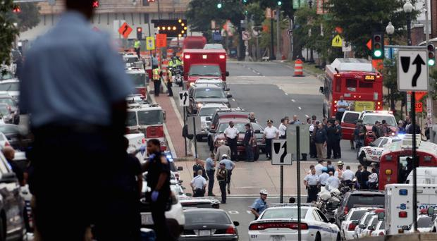 Emergency vehicles and law enforcement personnel respond to a reported shooting at the Washington Navy Yard September 16, 2013 in Washington, DC