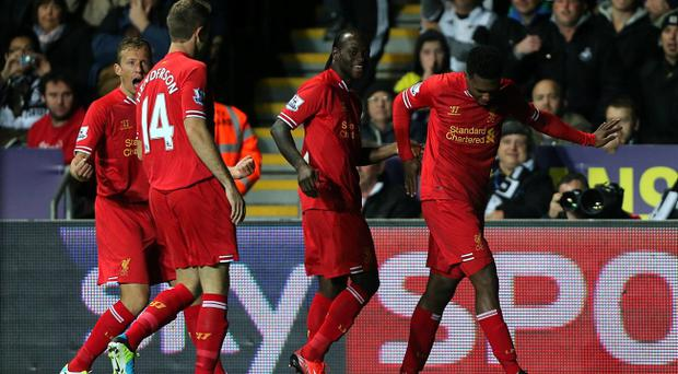 Liverpool's Daniel Sturridge (right) celebrates with team-mates after scoring his sides first goal of the game during the Barclays Premier League match at the Liberty Stadium, Swansea. Monday September 16, 2013. Nick Potts/PA Wire.