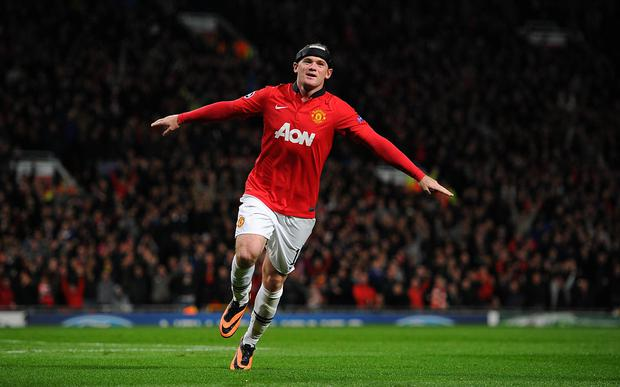 Manchester United's Wayne Rooney celebrates scoring his second goal of the game during the UEFA Champions League Group A match at Old Trafford