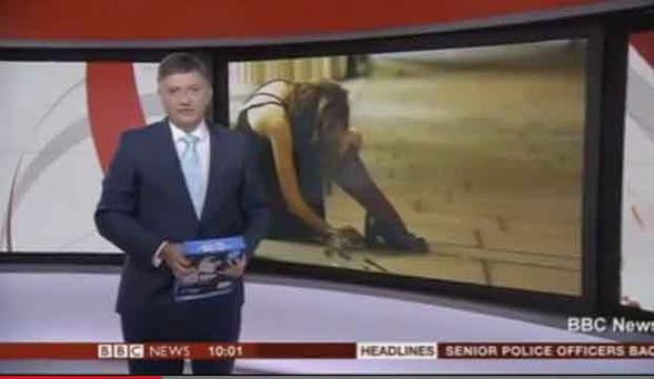 BBC news presenter Simon McCoy pictured live on air holding...printer paper...