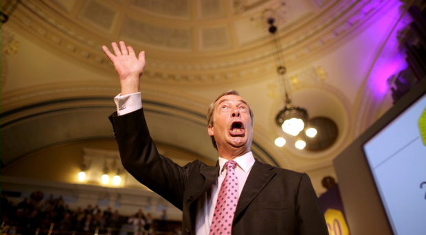 Leader of UKIP Nigel Farage takes the applause after addressing delegates during his keynote speech on September 20, 2013 in London, England. M