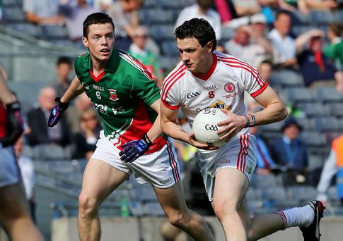 Defeat for Tyrone: Tyrone's Ronan Nugent and Stephen Coen of Mayo Pic: Lorraine O'Sullivan