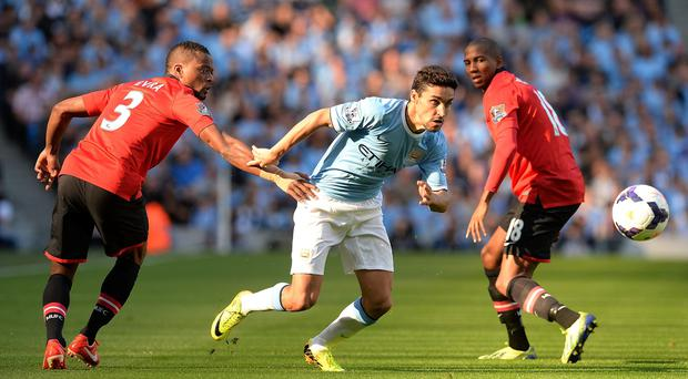 Jesus Navas (centre) in action with Manchester United's Patrice Evra (left) and Ashley Young